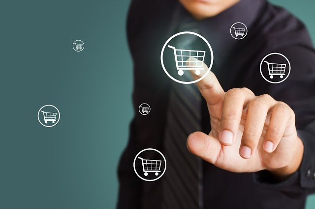 15892058 - business man pressing shopping cart icon