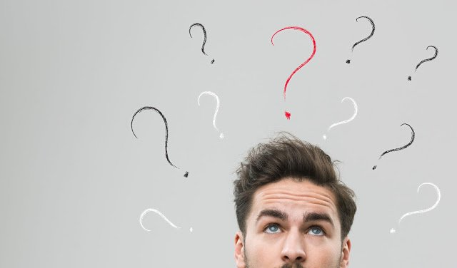 40062867 - thinking man with many question marks above his head, against grey background